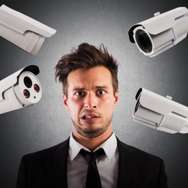 businessman with cameras pointed at him