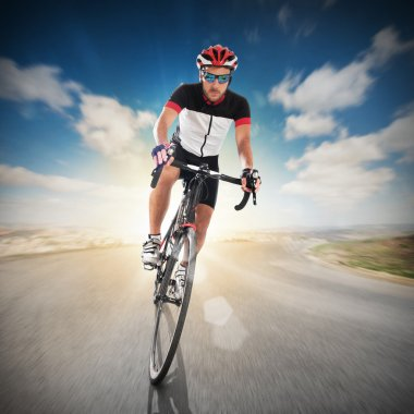 Cyclist with helmet on road
