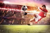 Fotbalový hráč hrát na stadionu
