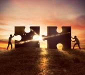 Photo Men push two puzzle pieces