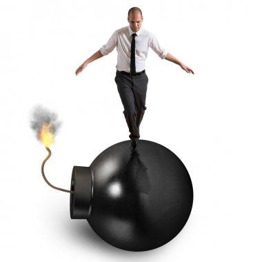 Businessman walking over bomb with lit fuse stock vector