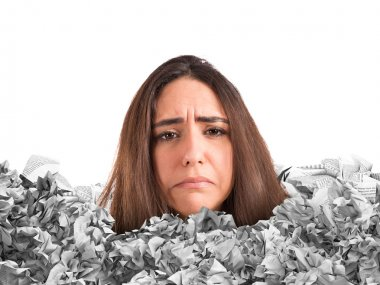 Sad woman trapped in a mountain of paperwork stock vector