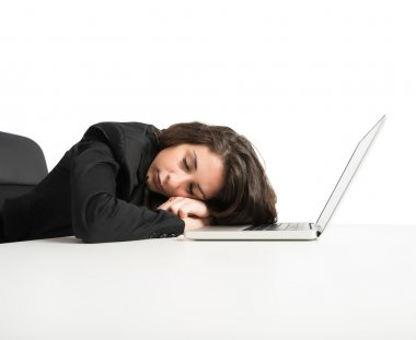 Woman exhausted from overwork sleeping