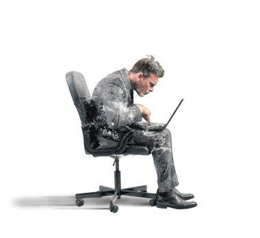 Businessman frozen with laptop