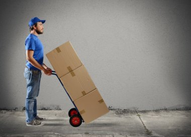 Courier with boxes on a cart