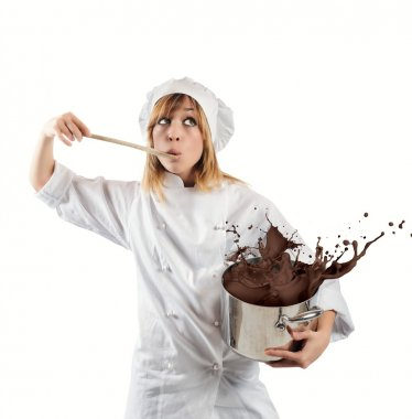 Female chef with chocolate in pot