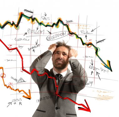 Businessman stressed out by the financial collapse