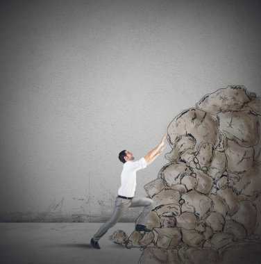 Businessman struggling to climb the success