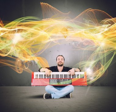 Artist plays the piano