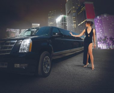 Woman touches her limousine