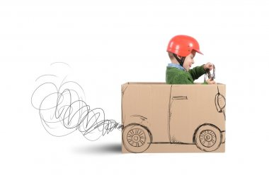 Baby plays with cardboard car