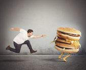 Férfi fut a fogási szendvics