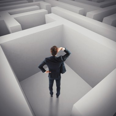 Businessman lost in a maze
