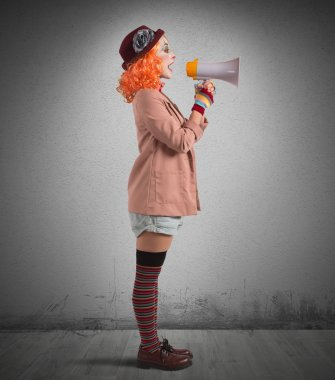 Clown with megaphone announces
