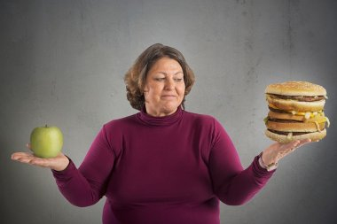 Woman with apple and burger