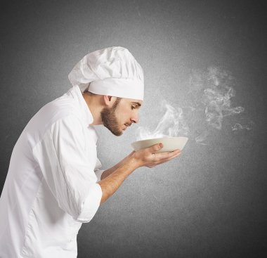 Chef smelling the aroma of dish