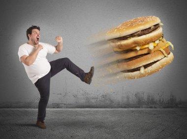 Fat man kicks sandwich