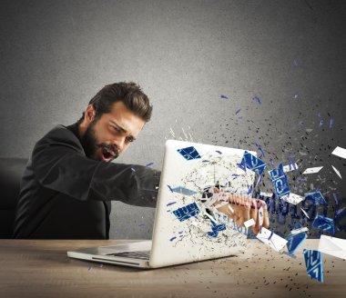 businessman breaks the pc in office