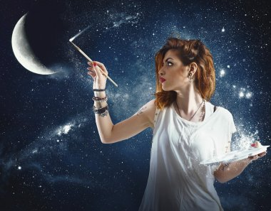Girl paints the moon