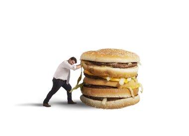 Man ushing  unhealthy sandwich
