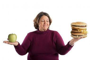 Woman undecided whether to start the diet