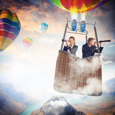 Business people with binoculars in hot air balloon