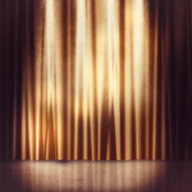 golden curtains of a stage