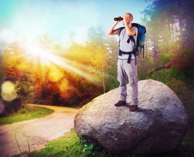 Explorer watching with binoculars