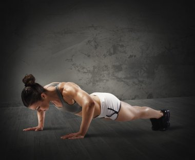 Muscular woman doing push up