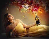Fotografie Woman opens a bottle of wine