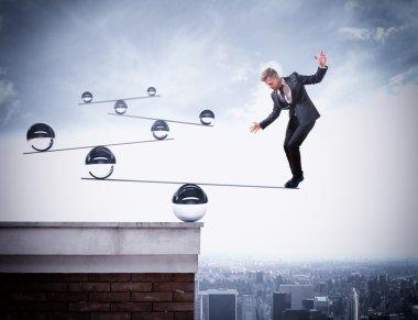 Businessman balancing on boards