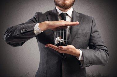 Boss holds caged businessmen