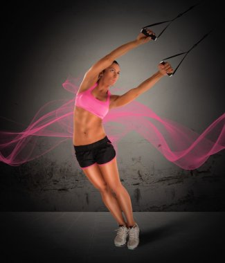 Woman training with the TRX