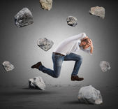 Fotografie Businessman escapes from stone storm