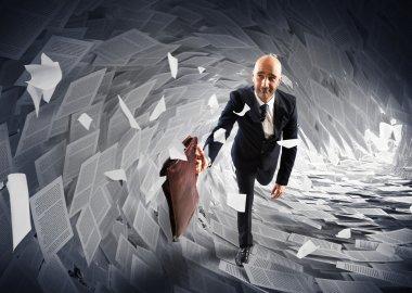 Worried businessman runs away from a paperwork wave stock vector