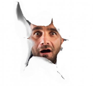 Man peeking through a hole
