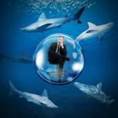 Businessman safely in a bubble