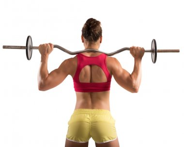 Muscular woman lifting an outrigger