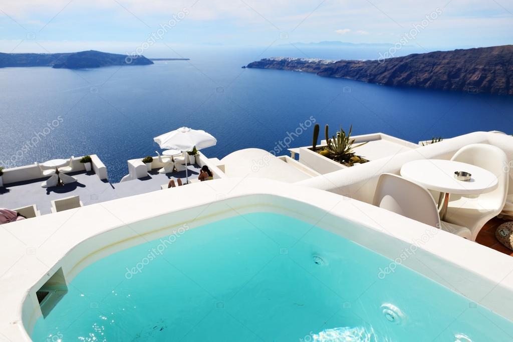 The sea view jacuzzi at luxury hotel, Santorini island, Greece ...