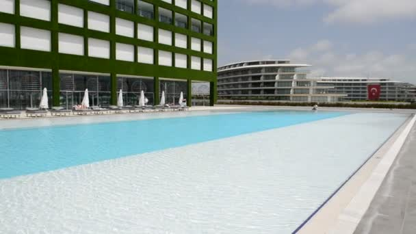 Panning left of building and swimming pool at the modern luxury hotel, Antalya, Turkey