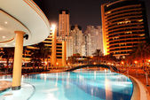 The swimming pool at luxury hotel in night illumination, Dubai,