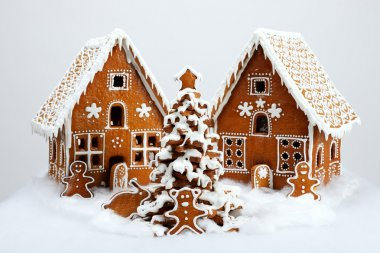 The hand-made eatable gingerbread houses and New Year Tree with