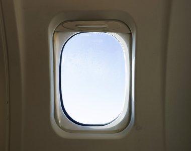 Window in turbopropeller aircraft interior stock vector