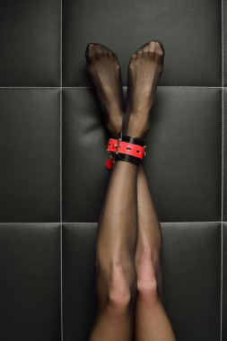 woman's bounded legs