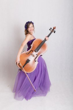 slim girl with cello