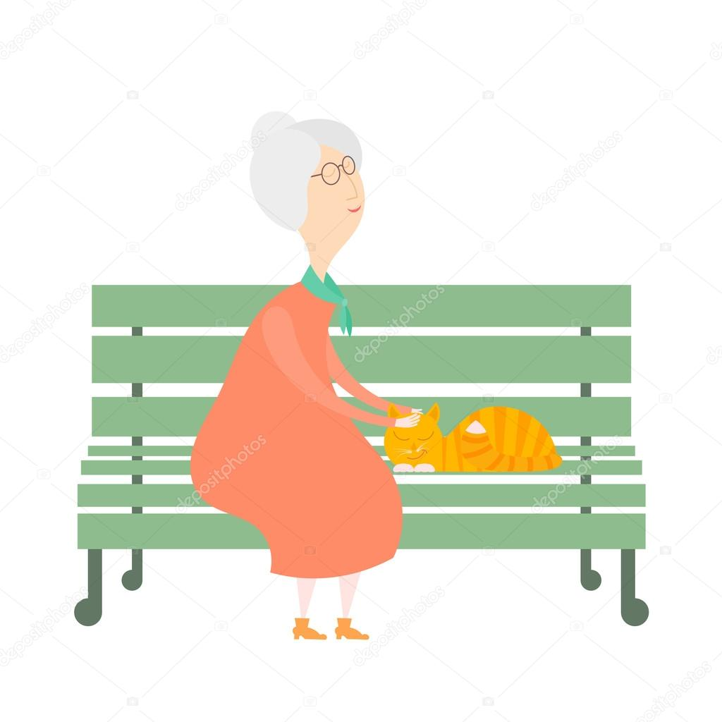 The old woman and a cat on the bench. An old woman with a red ca