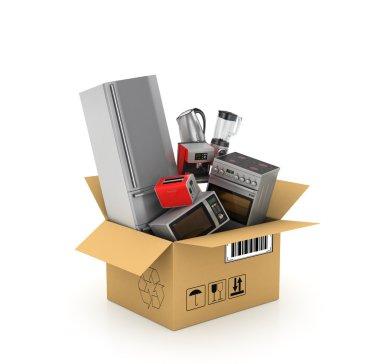 Kitchen appliances in cardboard box. Blender, toaster, coffee ma