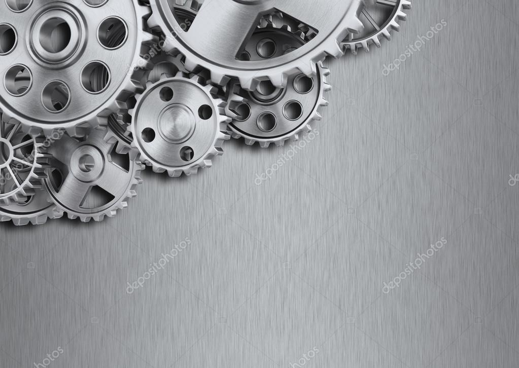 Steel gear wheels on metal background