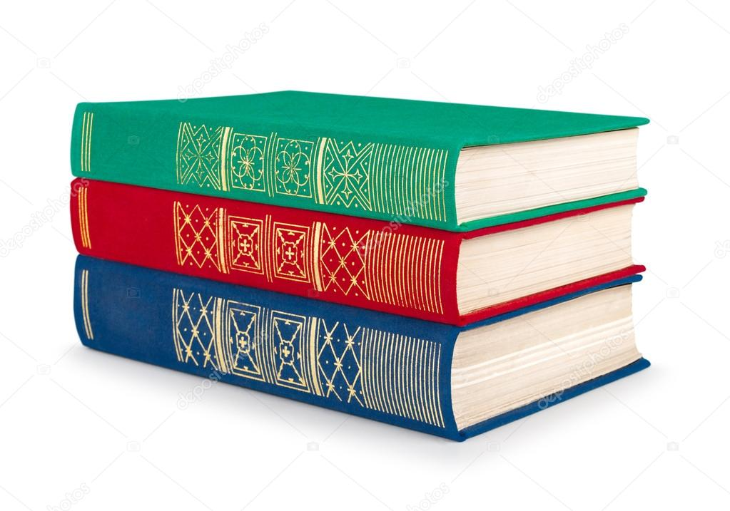 stack of vintage red, green and blue books on white isolation ...