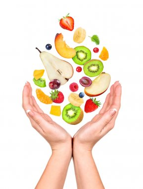 Concept: slim figure in your hands. Different fruits and berries